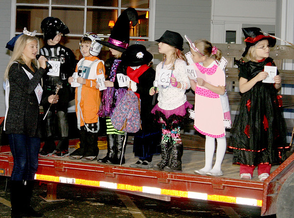 Paige Harder, Zionsville Miss Fall Festival's Outstanding Teen 2014, interviews Halloween costume contest entrants during the Boone Village Halloween Party Tuesday, Oct. 29.