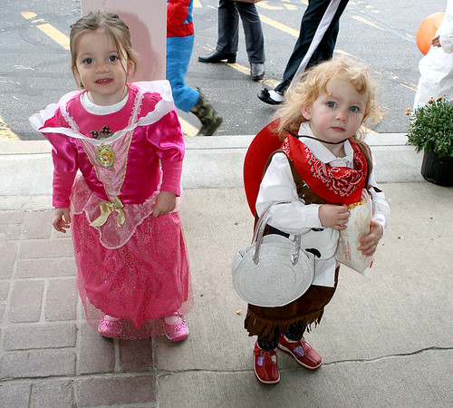 Princess Avanell Roberts, 2, and cowgirl Hadley Clark, 23 months, enjoy the festivities with Amanda Clark at the Boone Village Halloween Party Tuesday evening, Oct. 29.