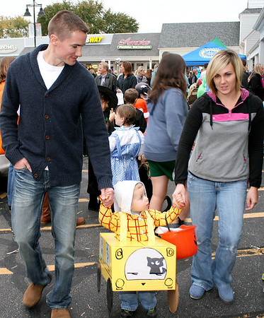 """Two-year-old Clark Williams gets a hand from mom and dad, Colie and Matt Williams. His parents said Clark wanted to dress like a bus driver for the Boone Village Halloween Party, Tuesday, Oct. 29, because bus drivers make money. His """"bus"""" was Clark County bus No. 6611, named for him and his June 6, 2011, birthdate."""