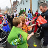 KRISTOPHER RADDER — BRATTLEBORO REFORMER<br /> Bellows Falls police officer Joshua Paulette hands out candy to students at Central Elementary School as they completed their costume parade on Thursday, Oct. 31, 2019.