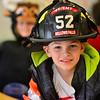 KRISTOPHER RADDER — BRATTLEBORO REFORMER<br /> Austin Bebey dresses as a firefighter for the Bellows Falls' Central Elementary School parade on Thursday, Oct. 31, 2019.