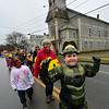 KRISTOPHER RADDER — BRATTLEBORO REFORMER<br /> Arthur Smith flexes as he marches in the parade.