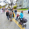 KRISTOPHER RADDER — BRATTLEBORO REFORMER<br /> Parents line the street of Atkinson Street, in Bellows Falls, as they watch their children walk in the annual Halloween parade on Oct. 31, 2018.