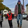 KRISTOPHER RADDER — BRATTLEBORO REFORMER<br /> Eddie Walsh holds his 5-year-old son's, Noah Haskell, hand during the annual Central Elementary Halloween parade, in Bellows Falls, on Oct. 31, 2018.
