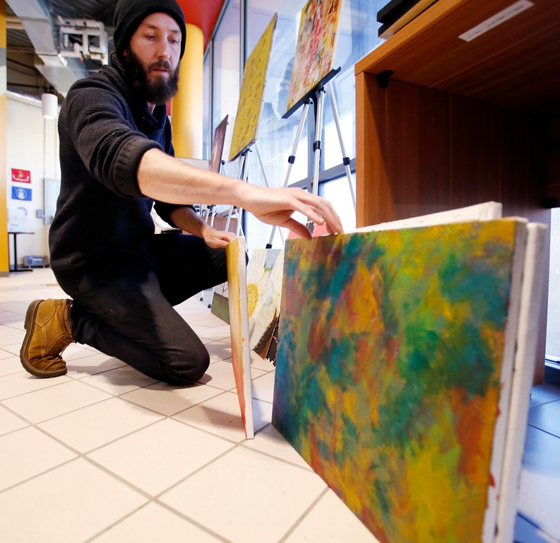 . Soldier On Art Director Nathan Hanford displays artwork by current and former Soldier On residents for the First Fridays Artswalk at the Veterans Transportation Center at the Intermodal Center in Pittsfield. Thursday, October 6, 2016. Stephanie Zollshan � The Berkshire Eagle | photos.berkshireeagle.com