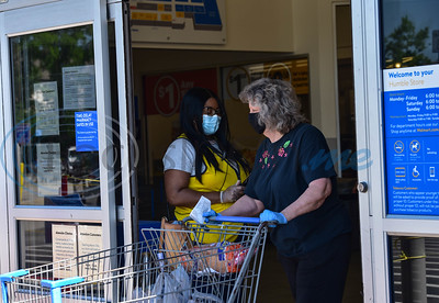 A shopper at a north Houston Walmart leaves the store while wearing a mask. Currently only Walmart employees are required to wear masks. However, starting Monday, April 27 anyone wishing to enter the store must be wearing a mask per orders put out by Harris County Judge Lina Hidalgo.