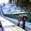 KRISTOPHER RADDER - BRATTLEBORO REFORMER<br /> Jeff Kneeland, from Evans Construction, drills in PVC that will allow skiers to glide on the newly remolded inrun at the Harris Hill Ski Jump on Tuesday, Feb. 13, 2018.