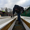 KRISTOPHER RADDER - BRATTLEBORO REFORMER<br /> Dan Boyd, of Evans Construction, drills in PVC that will allow skiers to glide on the newly remolded inrun at the Harris Hill Ski Jump on Monday, Feb. 12, 2018.