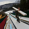 KRISTOPHER RADDER - BRATTLEBORO REFORMER<br />  Drew Christiansen, of Evans Construction, carries up boards for the casing for the inrun at Harris Hill Ski Jump on Monday, Feb. 12, 2018.