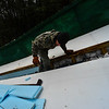 KRISTOPHER RADDER - BRATTLEBORO REFORMER<br /> Ryan Jones, of Evans Construction, works on installing insulation on the newly renovated inrun at the Harris Hill Ski Jump on Monday, Feb. 12, 2018.