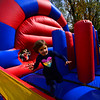 KRISTOPHER RADDER — BRATTLEBORO REFORMER<br /> Suzanna Hoskin, 4, from Dummerston, runs through an inflatable maze during The Putney School's 84th Harvest Festival on Sunday, Oct. 13, 2019.