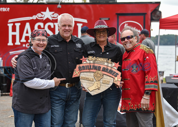 (From left) Chef Gail Huesmann, host Doug Hassell, host Kathy Pullin and Chef STRETCH smile for a photo while holding the Hassell Cattle Company Grilling Games winning trophy prior to the event at Lake Jacksonville on Saturday.