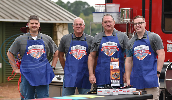 The Jacksonville Police Department team (from left) Captain Nathan Winship, Sergeant Royce McCullough, Chief Joe Williams and Captain Steven Markasky smile for a photo while competing against the Jacksonville Fire Department at the Hassell Cattle Grilling Games on Saturday.