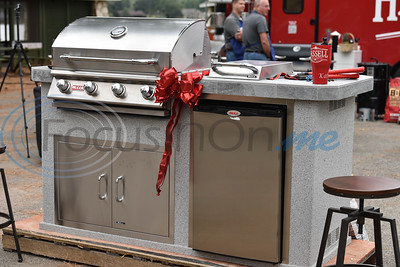A grill stands on display for the winner of the Hassell Company Grilling Games between the Jacksonville Police Department and Jacksonville Fire Department on Saturday.