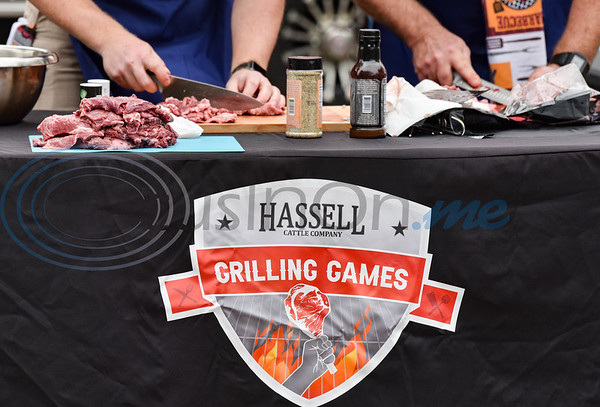Sliced Hassell Cattle Company beef is placed aside for grilling by the Jacksonville Police Department in a grilling contest against the Jacksonville Police Department at Lake Jacksonville on Saturday.