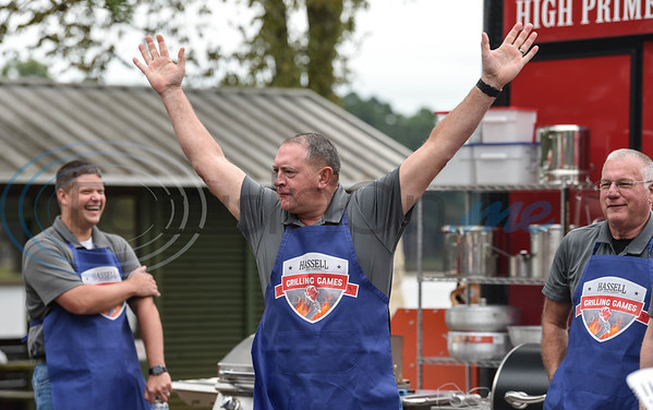 Jacksonville Police Department Chief and Hassell Cattle Company Grilling Games contestant Joe Williams gets the crowd going during the event on Saturday. The Police Department took on the Fire Department in a grilling contest at Lake Jacksonville.