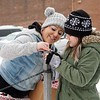 "BEN GARVER — THE BERKSHIRE EAGLE<br /> Karla Neff and her daughter Asena (green jacket) put hats and mittens out along walkways with a note saying ""Stay Warm in the Storm."" Monday, December 2, 2019."