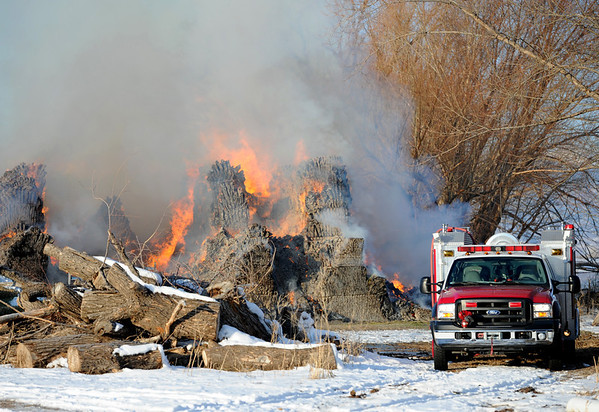 "Area firefighters and the Colorado State Patrol monitor a hay stack fire  on Botany Lane, near Hwy 287 and Isabelle Road on Friday morning.<br /> For a video and more photos of the fire, go to  <a href=""http://www.dailycamera.com"">http://www.dailycamera.com</a>.<br /> December 16, 2011 / Cliff Grassmick"