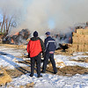 "Louisville firefighters and the Colorado State Patrol monitor a hay stack fire  on Botany Lane, near Hwy 287 and Isabelle Road on Friday morning.<br /> For a video and more photos of the fire, go to  <a href=""http://www.dailycamera.com"">http://www.dailycamera.com</a>.<br /> December 16, 2011 / Cliff Grassmick"