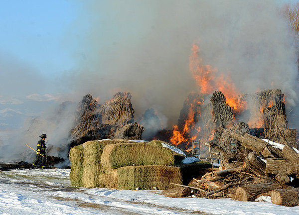 """Louisville firefighters and the Colorado State Patrol monitor a hay stack fire  on Botany Lane, near Hwy 287 and Isabelle Road on Friday morning.<br /> For a video and more photos of the fire, go to  <a href=""""http://www.dailycamera.com"""">http://www.dailycamera.com</a>.<br /> December 16, 2011 / Cliff Grassmick"""