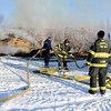 "Louisville firefighters prepare the water hose if it is needed.<br /> Louisville firefighters and the Colorado State Patrol monitor a hay stack fire  on Botany Lane, near Hwy 287 and Isabelle Road on Friday morning.<br /> For a video and more photos of the fire, go to  <a href=""http://www.dailycamera.com"">http://www.dailycamera.com</a>.<br /> December 16, 2011 / Cliff Grassmick"