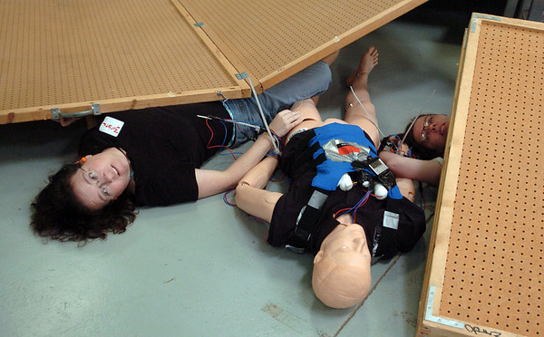 Barbara White, left, and Caroline O'Brien are victims that are strapped to a dead terrorist with a bomb taped to his chest during the exercise.<br /> The Longmont Fire Department hosted Operation Liberate, a full-scale hazardous materials exercise at the Boulder County Fairgrounds on Thursday.<br /> Cliff Grassmick / September 16, 2010