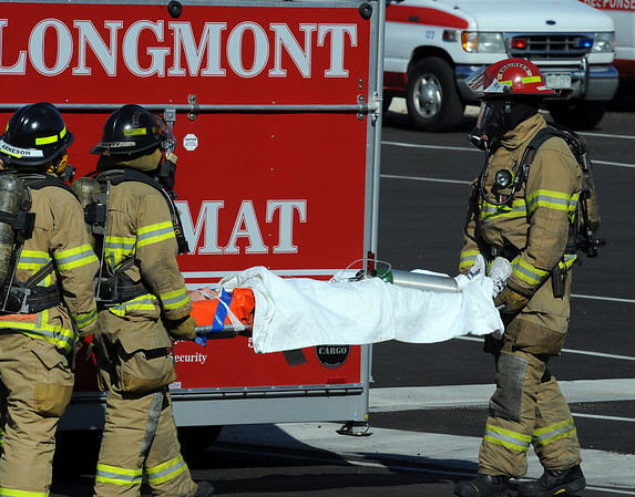 One of the victims is taken to an ambulance during the exercise.<br /> The Longmont Fire Department hosted Operation Liberate, a full-scale hazardous materials exercise at the Boulder County Fairgrounds on Thursday.<br /> Cliff Grassmick / September 16, 2010