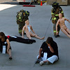 Victims are taken out of  a political rally where a gas bomb exploded during the exercise.<br /> The Longmont Fire Department hosted Operation Liberate, a full-scale hazardous materials exercise at the Boulder County Fairgrounds on Thursday.<br /> Cliff Grassmick / September 16, 2010