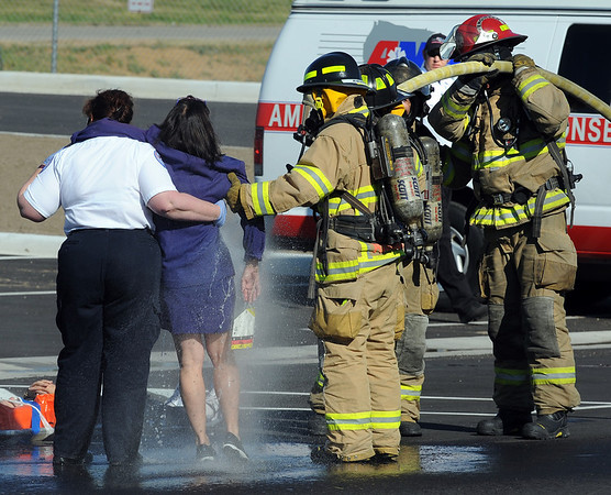 One of the victims of the WMD scenario is sprayed down during the exercise.<br /> The Longmont Fire Department hosted Operation Liberate, a full-scale hazardous materials exercise at the Boulder County Fairgrounds on Thursday.<br /> Cliff Grassmick / September 16, 2010