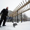 BEN GARVER – THE BERKSHIRE EAGLE<br /> Shea Gibbs shovels at Sottile Park on North Street in Pittsfield, Wednesday, February 7, 2018. Heavy snow showers caused low visability throught the day.
