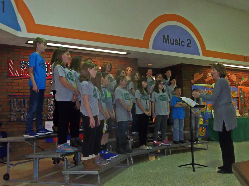 NIKKI RHOADES / GAZETTE The Heritage Elementary Glee Club performed to conclude the school's 40th anniversary celebration.