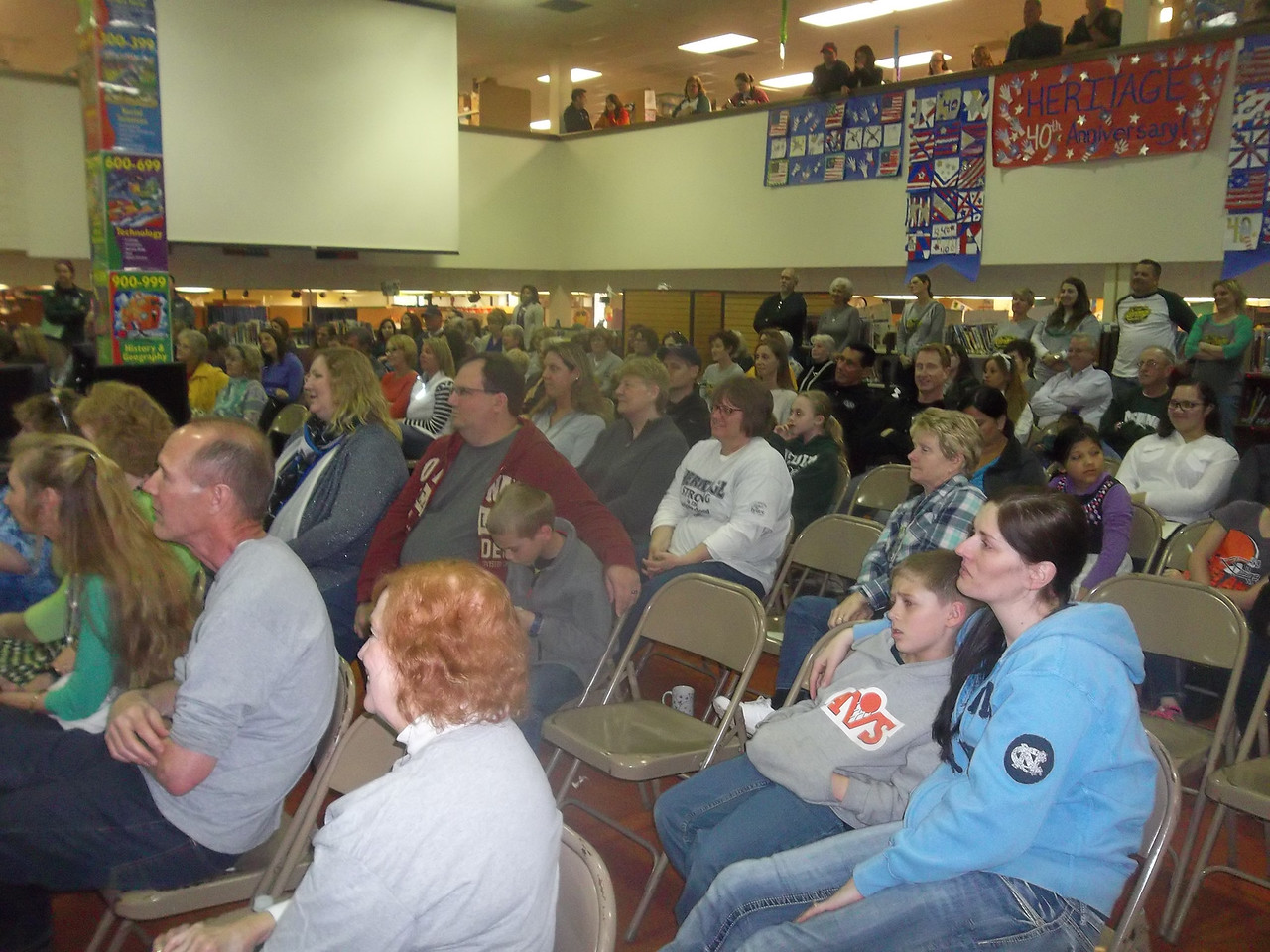 NIKKI RHOADES / GAZETTE Audience members listened Saturday as speakers celebrated the 40th anniversary of Medina's Heritage Elementary School talked about their experiences at the school.