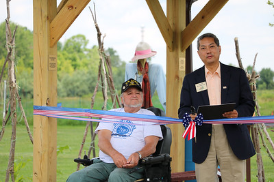 LUCAS FORTNEY / GAZETTE Brunswick Mayor Ron Falconi stands beside Brunswick Historical Society President Carl Bilski before they cut a ribbon to the Children's Garden.