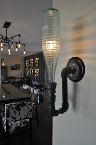ASHLEY FOX / GAZETTE The lower level at High and Low Winery has rustic décor, while the upper levels feel more elegant.