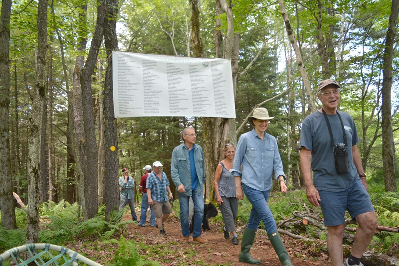 GILLIAN JONES — THE BERKSHIRE EAGLE<br /> The New Marlborough Land Trust's 'Hike-able Feast' celebrated the opening of a newly created 1.3 loop trail at the recently acquired New Marlborough Preserve. The celebration featured four stations of food prepared and sourced from Gedney Farm, The Flour Bin, Berkshire Bounty Farm, The Farm New Marlborough, and Mill River Farm. The new trail started beneath an eight-foot banner listing the 200 people who contributed to the Preserve. Sunday, July 16, 2017.