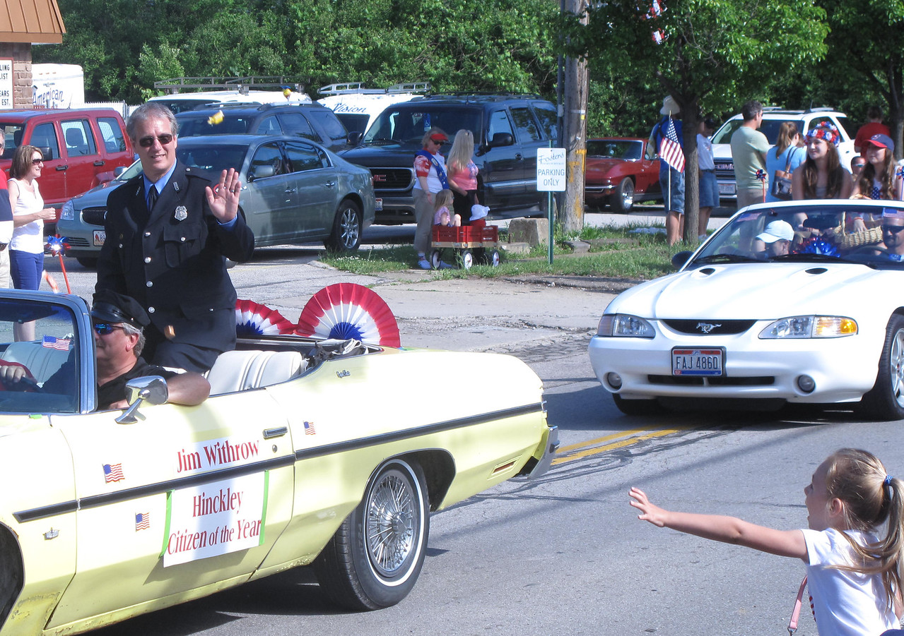 ELIZABETH DOBBINS / GAZETTE Jim Withrow, Hinckley firefighter and recently named citizen of the year waves at the crowd as he passes by during the Memorial Day parade in Hinckley Township.