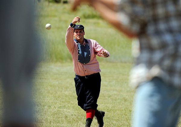 """John """"Crush"""" Sumner pitches the ball on Sunday, July 31, during a historic baseball game at Walker Ranch in Boulder County. For more photos of the game go to  <a href=""""http://www.dailycamera.com"""">http://www.dailycamera.com</a><br /> Jeremy Papasso/ Camera"""