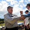 """""""Fast Eddy"""" Phelan shakes his teammates hands as the starting lineup is introduced on Sunday, July 31, during a historic baseball game at Walker Ranch in Boulder County. For more photos of the game go to  <a href=""""http://www.dailycamera.com"""">http://www.dailycamera.com</a><br /> Jeremy Papasso/ Camera"""