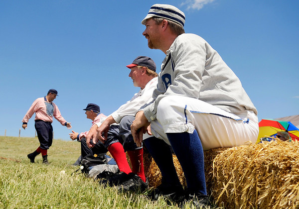 "Denver Blue Socks Michael ""Shark"" Renker, right, sits on a hay bench in the first inning on Sunday, July 31, during a historic baseball game at Walker Ranch in Boulder County. For more photos of the game go to  <a href=""http://www.dailycamera.com"">http://www.dailycamera.com</a><br /> Jeremy Papasso/ Camera"