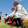 """Denver Blue Socks Michael """"Shark"""" Renker, right, sits on a hay bench in the first inning on Sunday, July 31, during a historic baseball game at Walker Ranch in Boulder County. For more photos of the game go to  <a href=""""http://www.dailycamera.com"""">http://www.dailycamera.com</a><br /> Jeremy Papasso/ Camera"""