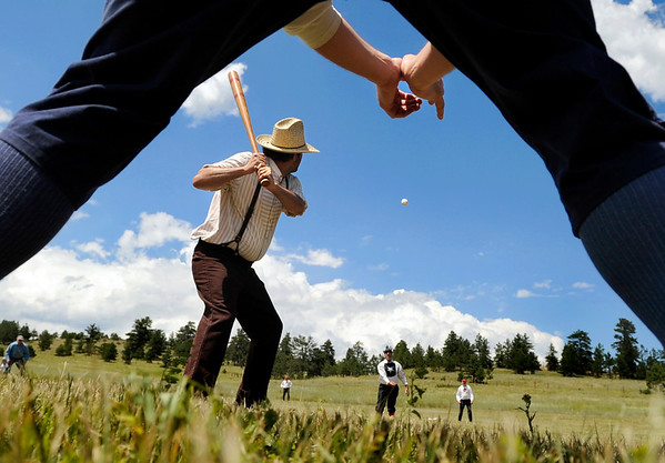 """Craig """"Crusher"""" Sommers takes a swing at a pitch on Sunday, July 31, during a historic baseball game at Walker Ranch in Boulder County. For more photos of the game go to  <a href=""""http://www.dailycamera.com"""">http://www.dailycamera.com</a><br /> Jeremy Papasso/ Camera"""