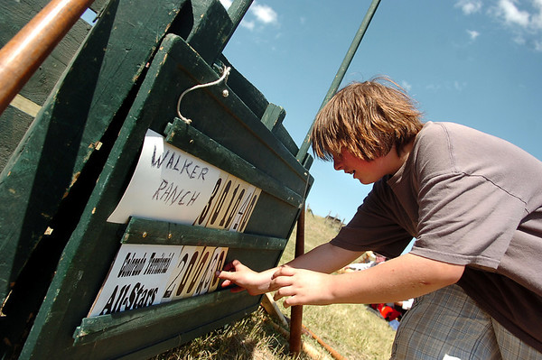 "Scorekeeper Noah Orlowski adds to the scoreboard on Sunday, July 31, during a historic baseball game at Walker Ranch in Boulder County. For more photos of the game go to  <a href=""http://www.dailycamera.com"">http://www.dailycamera.com</a><br /> Jeremy Papasso/ Camera"