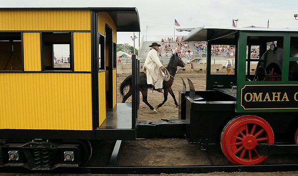 A member of the Sontag-Evans gang cases the train they plan to rob during a re-enactment on Saturday at the Nicollet County Fair of an historic train robbery attempt that occurred near St. Peter in 1982. Photo by John Cross