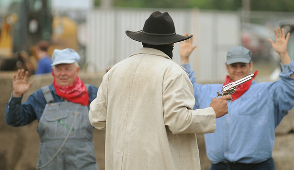 One of the Sontag-Evans gang members brandishes a pistol during a re-enactment on Saturday at the Nicollet County Fair of a train robbery that was committed on July 1, 1892 between St. Peter and Mankato. Photo by John Cross