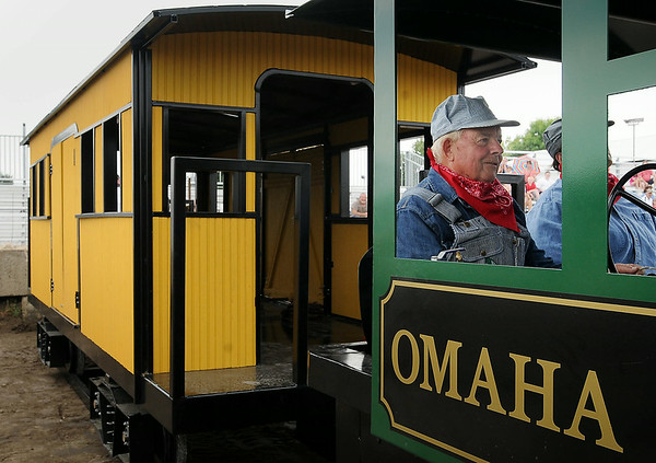 Arnie Lillo drives the train he built in his rural Good Thunder metal shop, during a re-enactment on Saturday at the Nicollet County Fair of a train robbery attempted between Kasota and St. Peter in 1892. Photo by John Cross