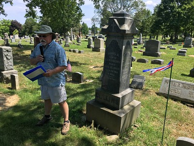 Paul Wood, a member of the Medina County Historical Society, tells the sad story of James Collins, who was buried at Spring Grove Cemetery. BOB SANDRICK / GAZETTE