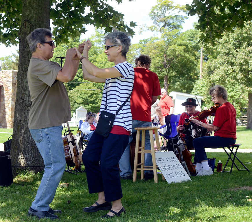 . Dennis Tranchita of Lyndhurst and Carolyn Jirousek of Solon break out into a Cajun dance as the Bayou Rhythms perform under a tree at the Raccoon County Music Festival in 2014 at the Century Village Museum in Burton. (News-Herald file)