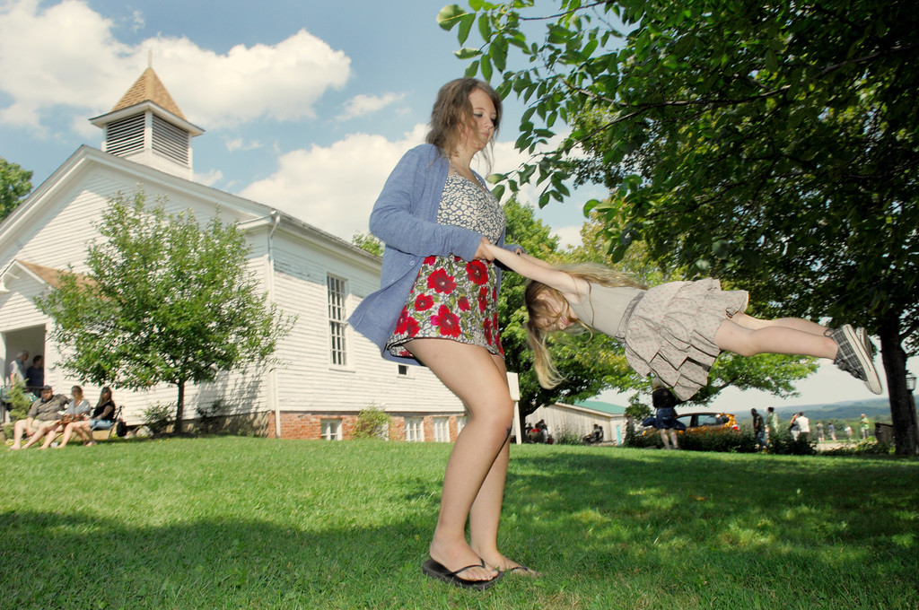 . Sierra Forester swings her cousin Nadia Corso between musical sets during thr Raccoon County Music Festival at Century Village in 2011. (News-Herald file)