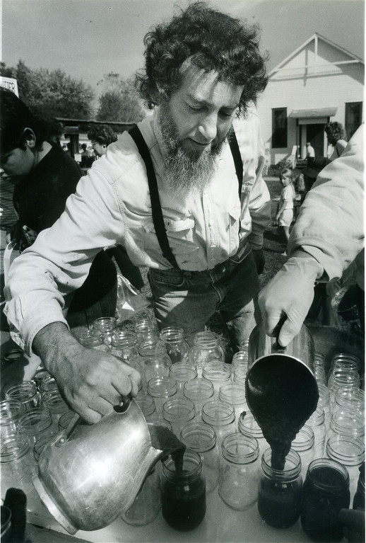 . Jim Wohlken, of Burton, pours some hot fresh apple butter into pint jars, which were sold to the public, on Oct. 14, 1989, at the Apple Butter Festival at Century Village in Burton. (News-Herald file)
