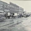 Photo provided by Lorain Historical Society <br> A horse-drawn B.H. Kroger Groceries cart parks in front of stores: Neisner Bros. Inc. 5 cent to $1.00 Store, and Cort Shoes, on Broadway Avenue from 4th Street to West Erie Avenue, Lorain.